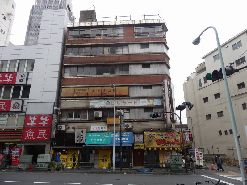 "Real life picture of Yoyogi Kaikan, an abandoned building featured in ""Weathering With you"""