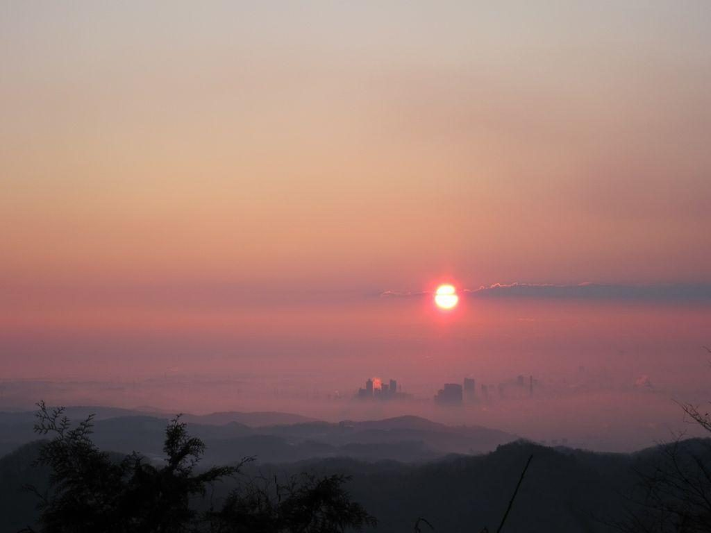 The sunrise over tokyo city, viewed from mount Takao during new year.
