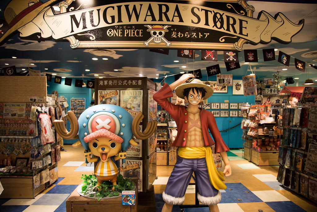 picture of the one Piece Mugiwara store with life size models of the main characters.