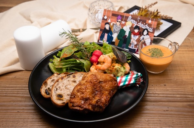 Banana Fish christmas meal featuring bread, salad, roast chicken and a soup.