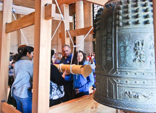 People ringing the bell at a Japanese temple during New Year