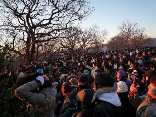 People watching the first sunrise of the New Year in Tokyo, Japan. Mount Takao.