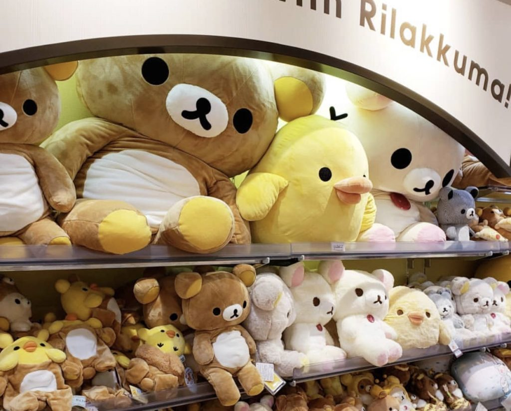 Rilakkuma plushies lined up in the Rilakkuma store