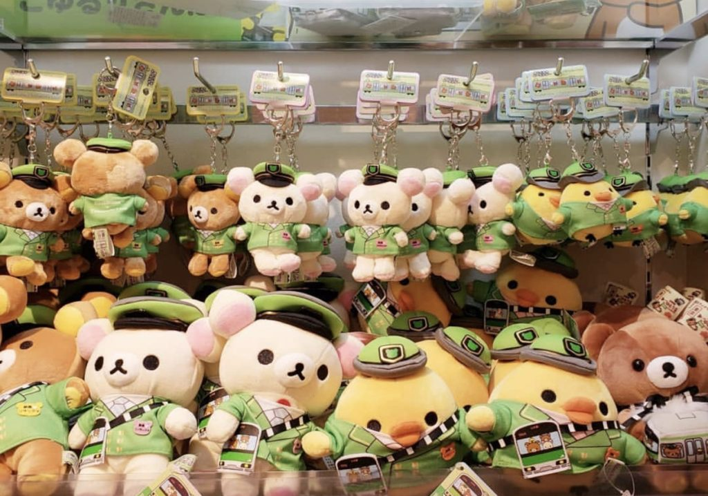 rilakkuma plushies dressed as train station attendants
